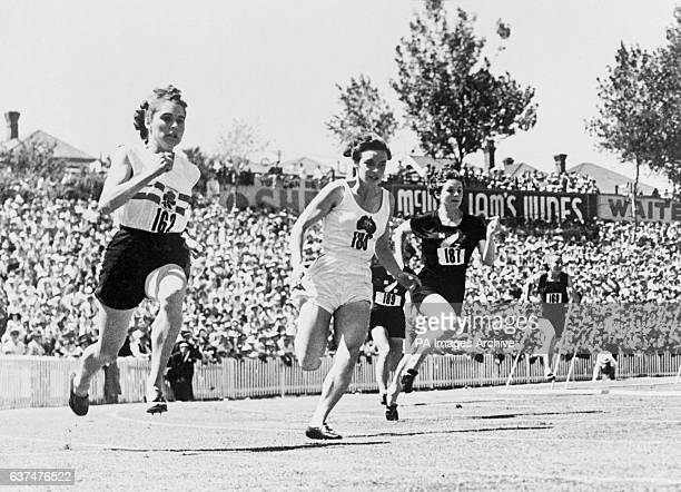 Entering the straight in the third heat of the Women's 220 yards Left to right Dorothy Manley Verna Johnston third Colleen Malone Dorothea Parker...