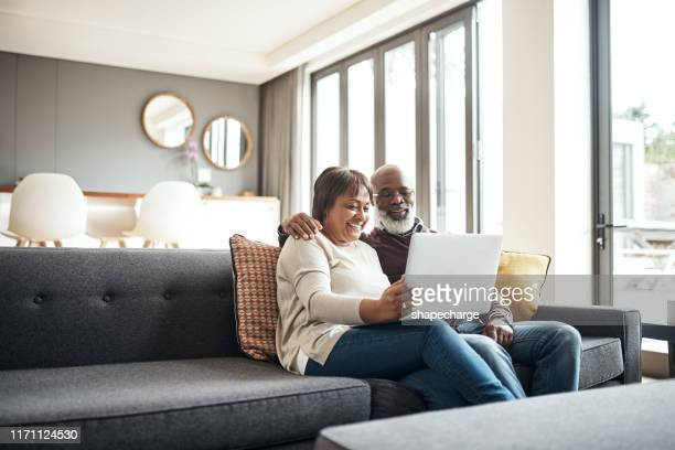 entertained in the comfort of our own home - senior couple stock pictures, royalty-free photos & images