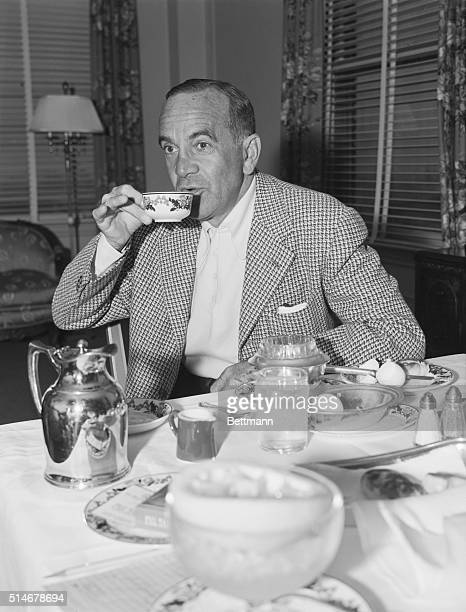Entertainer Al Jolson eats his breakfast in the Beverly Wilshire Hotel