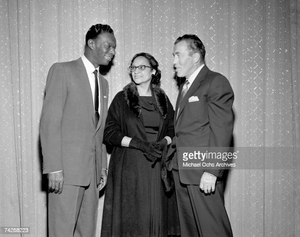 "Entertainer and pianist Nat ""King"" Cole chats with host of ""The Ed Sullivan Show"" Ed Sullivan and a woman on May 16, 1954 in New York City, New York."
