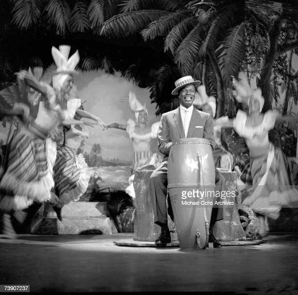 "Entertainer and pianist Nat ""King"" Cole performs on ""The Ed Sullivan Show"" May 16, 1954 in New York City, New York."