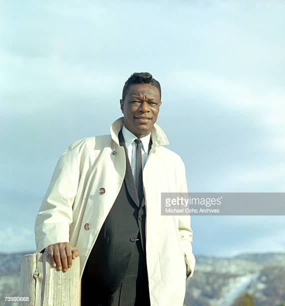 Entertainer and pianist Nat King Cole poses for a portrait session in 1964 in Los Angeles California