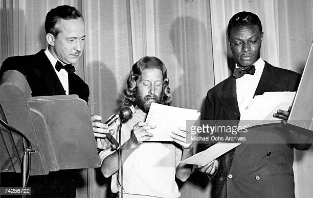 Entertainer and pianist Nat King Cole poses for a portrait with hit Nature Boy songwriter Eden Ahbez in 1948 in Los Angeles California