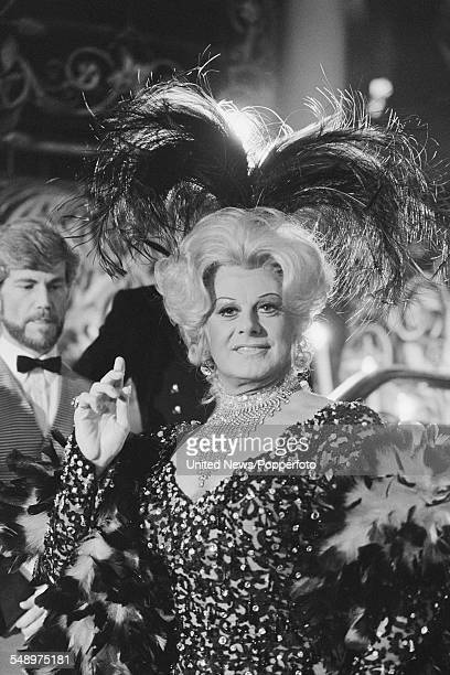 Entertainer and singer Danny La Rue pictured in female costume at the Cafe de Paris club in London on 11th May 1983