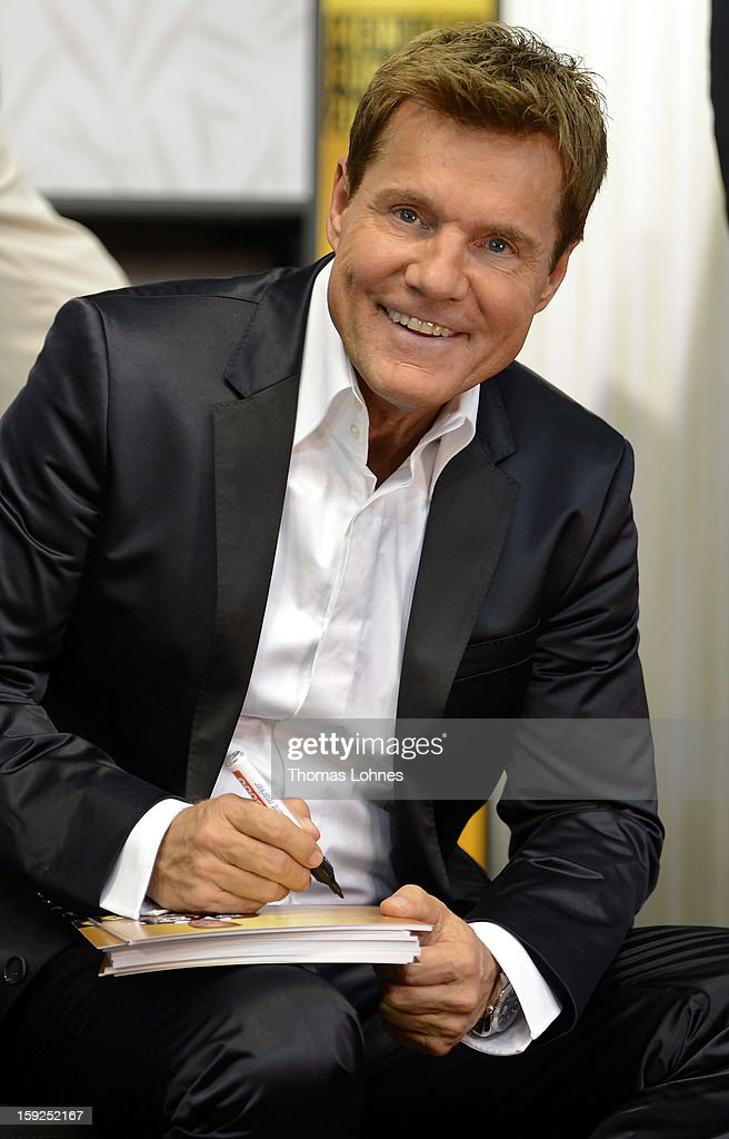 Entertainer and Singer Dieter Bohlen writes autographs after he has presented his wallpaper collection 'Dieter Bohlen - it's different' at the fair 'Heimtextil 2013' on January 10, 2013 in Frankfurt/Main, Germany. The self-proclaimed 'Poptitan' has launched its own wallpaper collection with the wallpaper manufacturer Pickhardt + Sieberthas from Gummersbach.