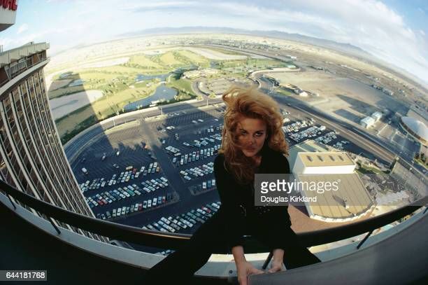 Entertainer AnnMargret sits on the railing of a hotel balcony in Las Vegas