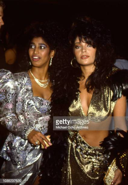 Entertainer Apollonia Kotero and Susan Moonsie of the female singing trio Apollonia 6 attend an event 1984 in Los Angeles California