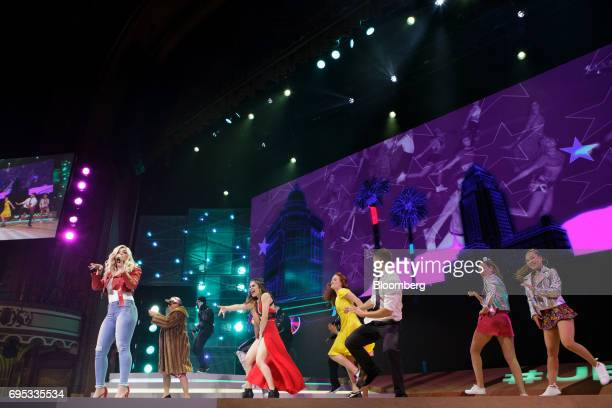 Entertainer Bebe Rexha left performs on stage during the announcement of the Just Dance 2018 video game during the Ubisoft Entertainment SA event...
