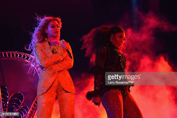 Entertainer Beyonce and tennis player Serena Williams perform on stage during closing night of 'The Formation World Tour' at MetLife Stadium on...