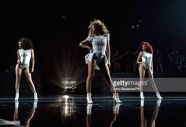 """Entertainer Beyonce performs on stage during """"The Mrs. Carter Show World Tour"""" at the Mohegan Sun Arena on August 2, 2013 in Uncasville, Connecticut...."""