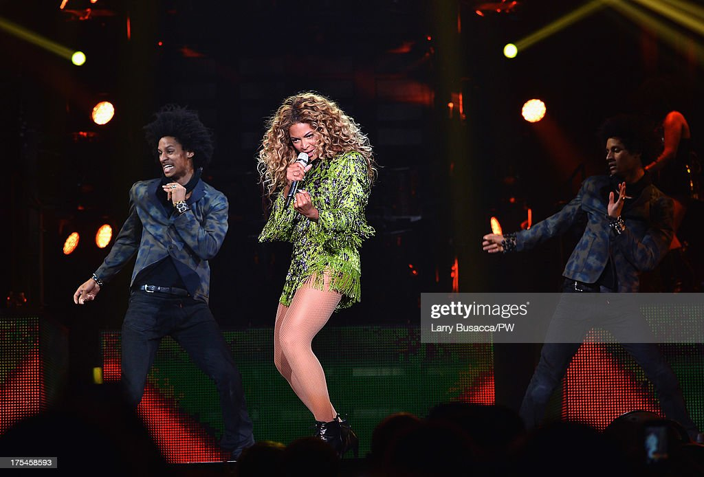 Entertainer Beyonce performs on stage during 'The Mrs. Carter Show World Tour' at the Mohegan Sun Arena on August 2, 2013 in Uncasville, Connecticut. Beyonce wears a leopard-print fringed mini-dress by Pucci and hosiery by Capezio.