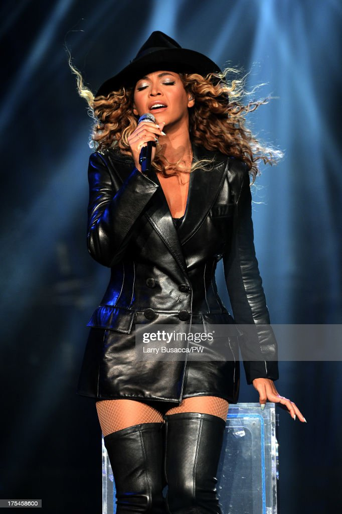 Entertainer Beyonce performs on stage during 'The Mrs. Carter Show World Tour' at the Mohegan Sun Arena on August 2, 2013 in Uncasville, Connecticut. Beyonce wears a coat by Pucci and hosiery by Capezio.