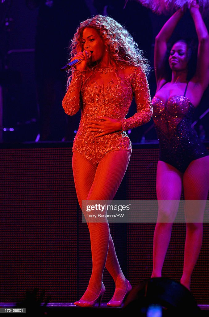 Entertainer Beyonce performs on stage during 'The Mrs. Carter Show World Tour' at the Mohegan Sun Arena on August 2, 2013 in Uncasville, Connecticut. Beyonce wears a custom gold and flesh-toned one piece by The Blonds, Stuart Weitzman shoes and hosiery by Capezio.