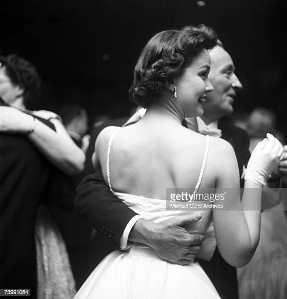 Entertainer Bing Crosby and his future wife Kathryn Grant attend the Academy Awards ceremony on March 30 1955 in Los Angeles California