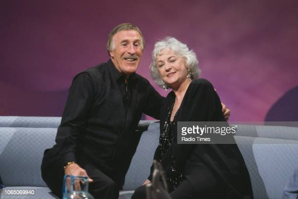 Entertainer Bruce Forsyth interviewing actress Bea Arthur for the BBC television show 'Bruce's Guest Night' 1992