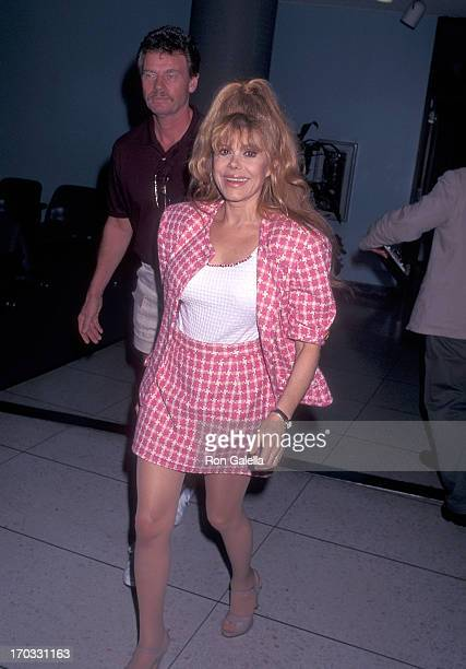 Entertainer Charo and husband Kjell Rasten depart for Miami Florida on September 5 1996 from the Los Angeles International Airport in Los Angeles...