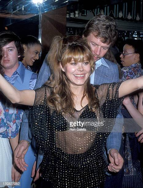 Entertainer Charo and husband Kjell Rasten on February 4 1979 dance at the El Privado Room Carlos'n Charlie's Restaurant in West Hollywood California