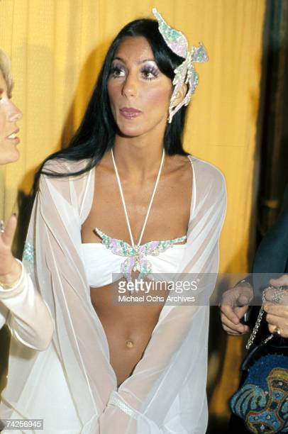 Entertainer Cher attends the Grammy awards wearing a large butterfly pin in her hair on March 2, 1974 in Los Angeles, California.