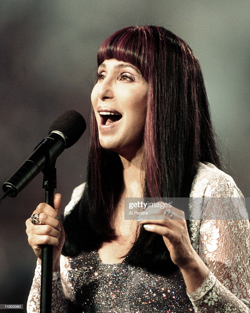 Entertainer Cher sings the national anthem at Super Bowl XXXIII which was held at Pro Player Stadium on January 31, 1999 in Miami, Florida.