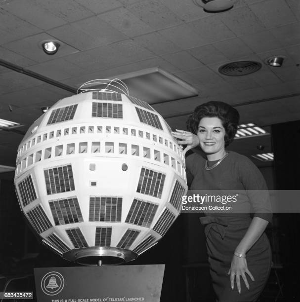 Entertainer Connie Francis next to a full scale model of 'Telstar' at Basin St East for WNEW on October 2 1962 in New York