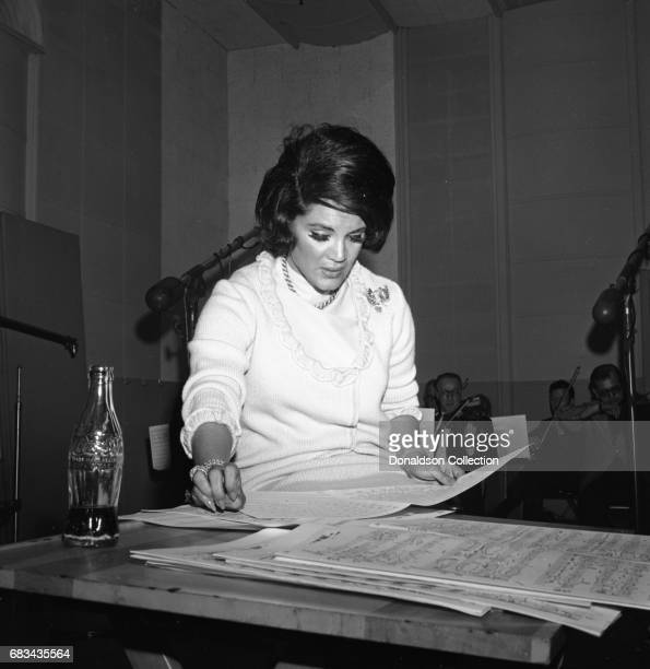 Entertainer Connie Francis recording with a bottle of Coca Cola on May 31 1966 in New York