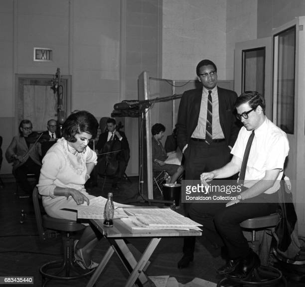 Entertainer Connie Francis recording with producer Tom Wilson with a bottle of Coca Cola on May 31 1966 in New York
