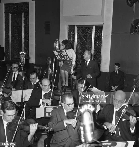 Entertainer Connie Francis records at Basin St East for WNEW on October 2 1962 in New York