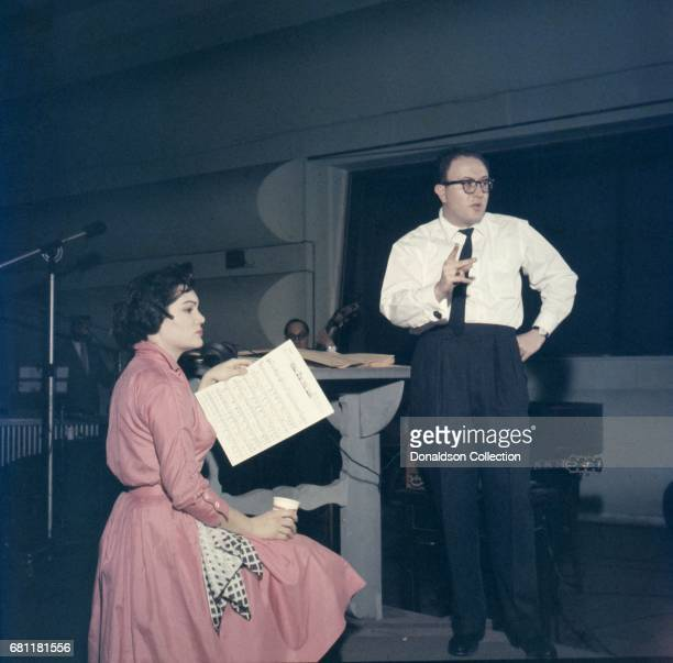Entertainer Connie Francis records in the studio with producer Ray Ellis at MGM in circa 1959 in New York