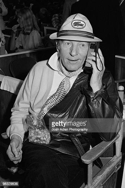 Entertainer Danny Kaye eats candy and listens to the Dodger game in Cincinnatti on his transister radio while attending the ballet featuring Mikhail...