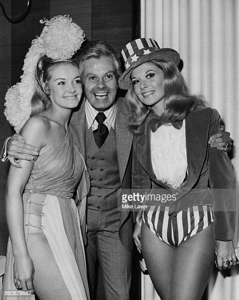 Entertainer Danny la Rue the famous female impressionist with his arms around Yvonne Ormes Miss United Kingdom and Sandra Anne Wolsfield Miss United...