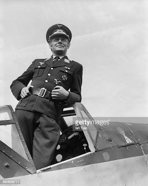 Entertainer Danny la Rue wearing a German 'SS' uniform as he stands in the cockpit of an aircraft filming scenes for the film 'Our Miss Fred' at an...