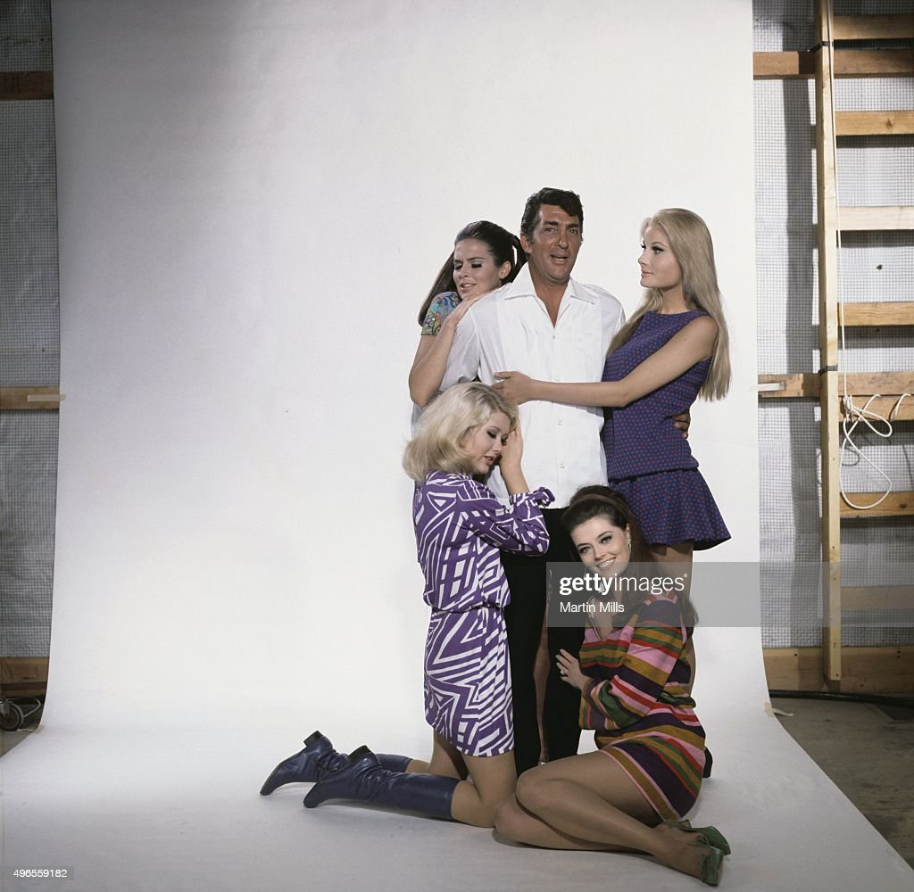 Entertainer Dean Martin as Matt Helm poses for a portrait with cast members Susannah Moore, Penny Brahms, Jan Watson, Alena Johnston from the Columbia Pictures film 'The Ambushers' in 1967 in Los Angeles, California.