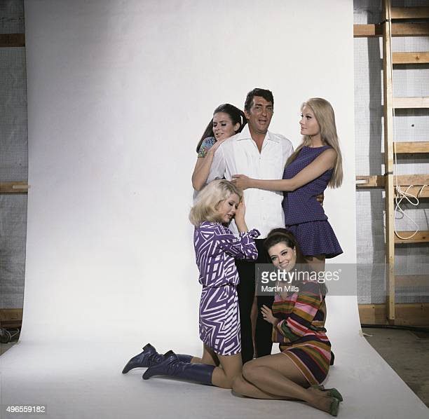 Entertainer Dean Martin as Matt Helm poses for a portrait with cast members Susannah Moore Penny Brahms Jan Watson Alena Johnston from the Columbia...