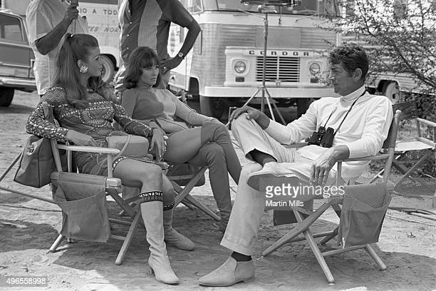 Entertainer Dean Martin as Matt Helm with cast members Senta Berger and Janice Rule on the set of the Columbia Pictures film 'The Ambushers' in 1967...