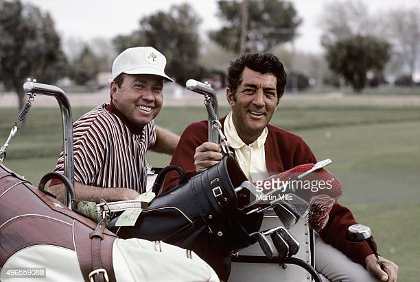 Entertainer Dean Martin plays golf with singer Don Cherry in 1967