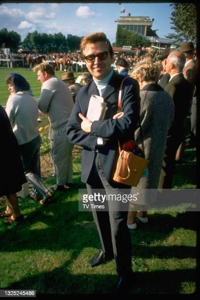 Entertainer Des O'Connor watching a horse race, circa 1969.