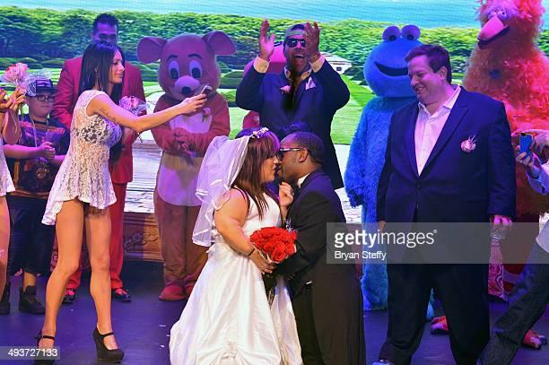 Entertainer Donnie Davis officiates over the wedding of mini Kim Kardasian and mini Kanye West as entertainment host Jeff Beacher witnessess the...