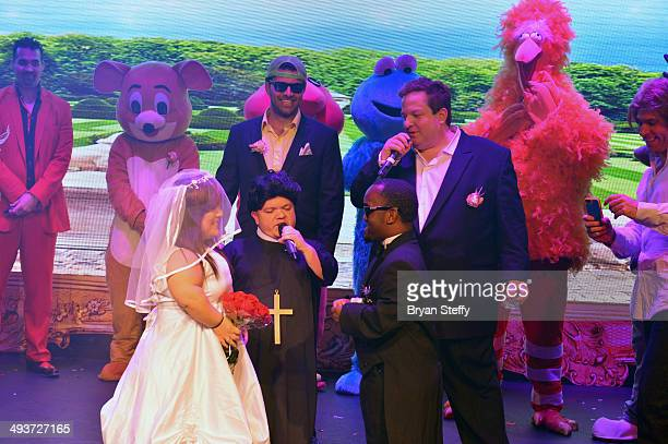 Entertainer Donnie Davis officiates over the wedding of mini Kim Kardasian and mini Kanye West as entertainment host Jeff Beacher witnessess the...