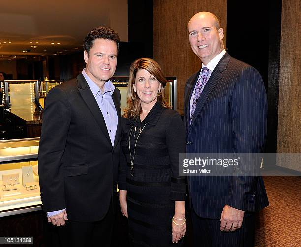 Entertainer Donny Osmond Tiffany Co director Suzy Nagle and Tiffany Co Group Director Peter Sinibaldi pose at Tiffany Co inside The Forum Shops at...
