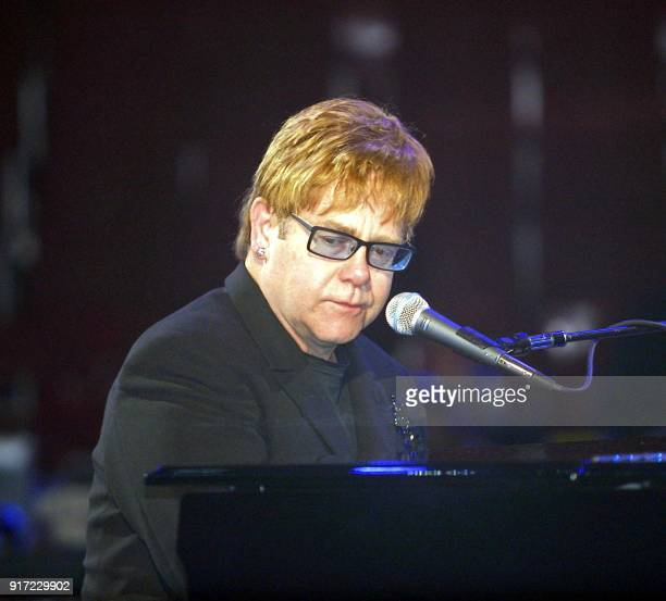 Entertainer Elton John does a sound check prior to the start of the NBA All Star Game to be held 10 Feb 2002 in the First Union Center in...
