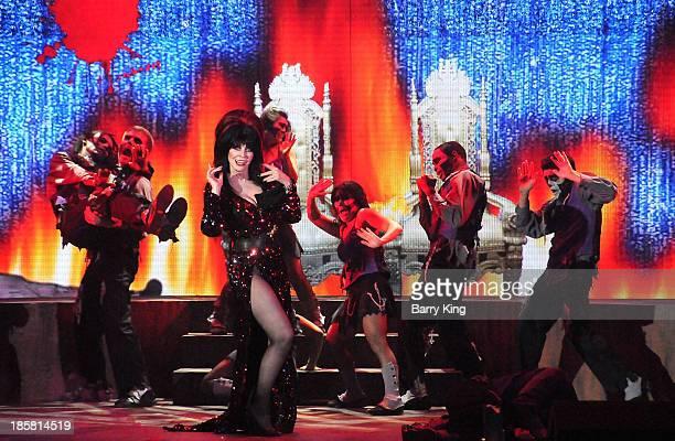 Entertainer Elvira performs in her 'Elvira's Sinema Seance' show at Knott's Scary Farm Halloween Haunt on October 24 2013 in Buena Park California