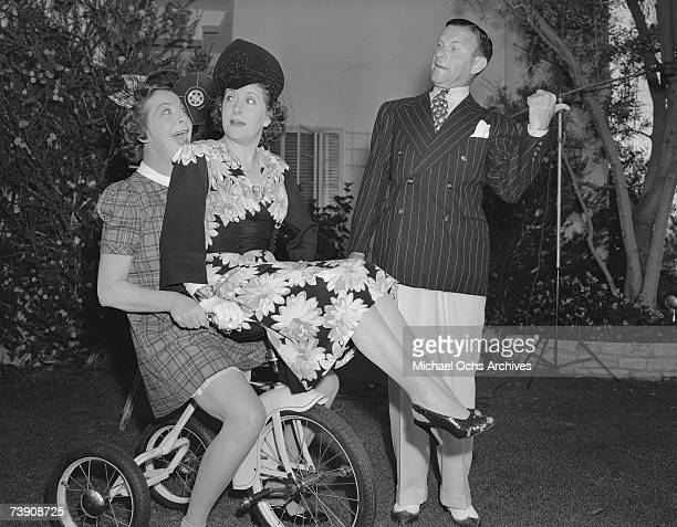 Entertainer Fanny Brice along with husband and wife comedy team George Burns and Gracie Allen ham it up for the camera at her birthday party on...