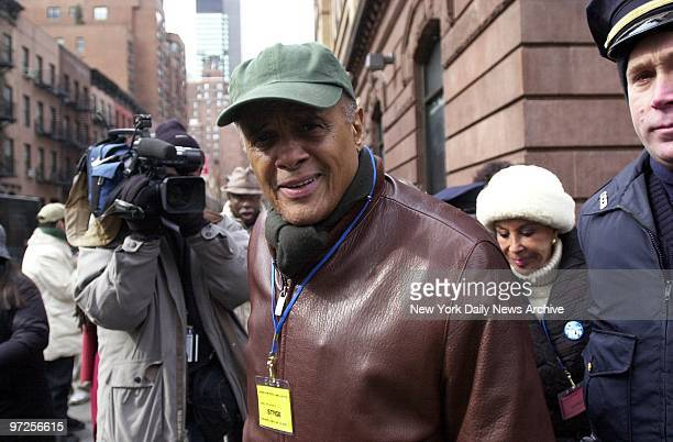 Entertainer Harry Belafonte and his wife Julie arrive to join a massive antiwar rally at First Ave and 51st St At least 100000 demonstrators decrying...