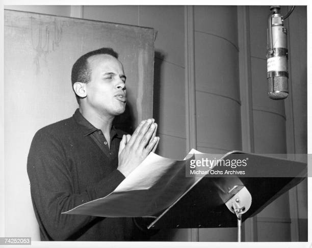 Entertainer Harry Belafonte records in the studio in circa 1960.