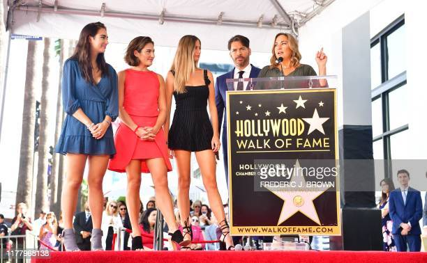 Entertainer Harry Connick Jr joined by his wife Jill and three daughters Georgia Sarah and Charotte on stage at his Hollywood Walk of Fame Star...