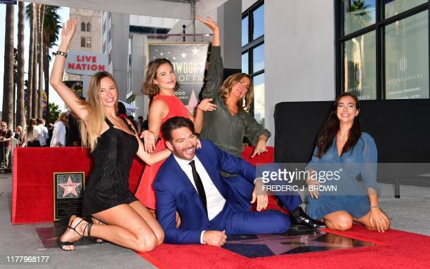 Entertainer Harry Connick Jr poses with his wife Jill and daughters Georgia Sarah and Charlotte on his Hollywood Walk of Fame Star during a ceremony...