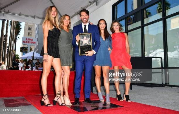 Entertainer Harry Connick Jr stands on his Hollywood Walk of Fame Star with his wife Jill and daughters Georgia Charlotte and Sarah during a ceremony...
