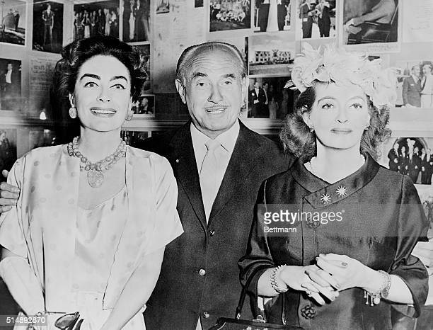 Entertainer Jack Warner is flanked by Joan Crawford and Bette Davis