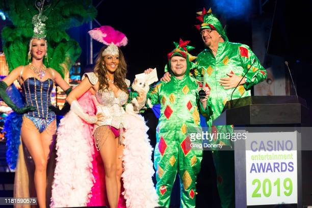Entertainer Jade Simone looks on as magician/comedian Piff the Magic Dragon accepts the Casino Comedian of the Year Award from Penn Jillette of the...