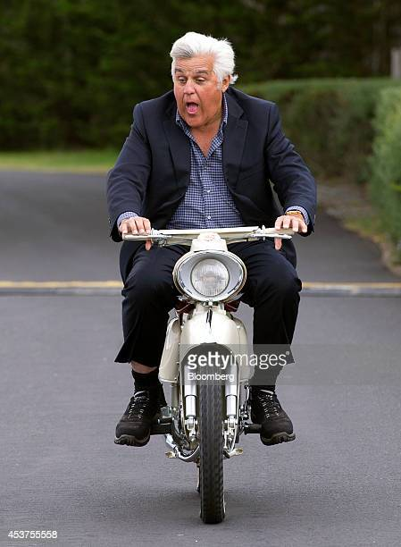 Entertainer Jay Leno rides a 1964 Zweirad Union Kavalier Type 115 motorcycle during the 2014 Pebble Beach Concours d'Elegance in Pebble Beach...